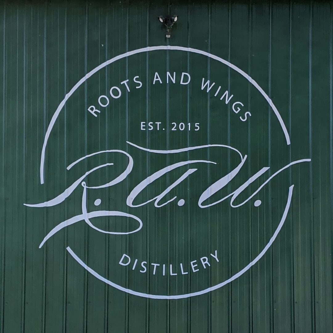 Roots and Wings Distillery Sign